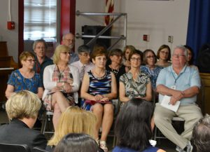 Group of about 15 retirees at the June 13 recognition ceremony, seated in the front of the Van Antwerp auditorium