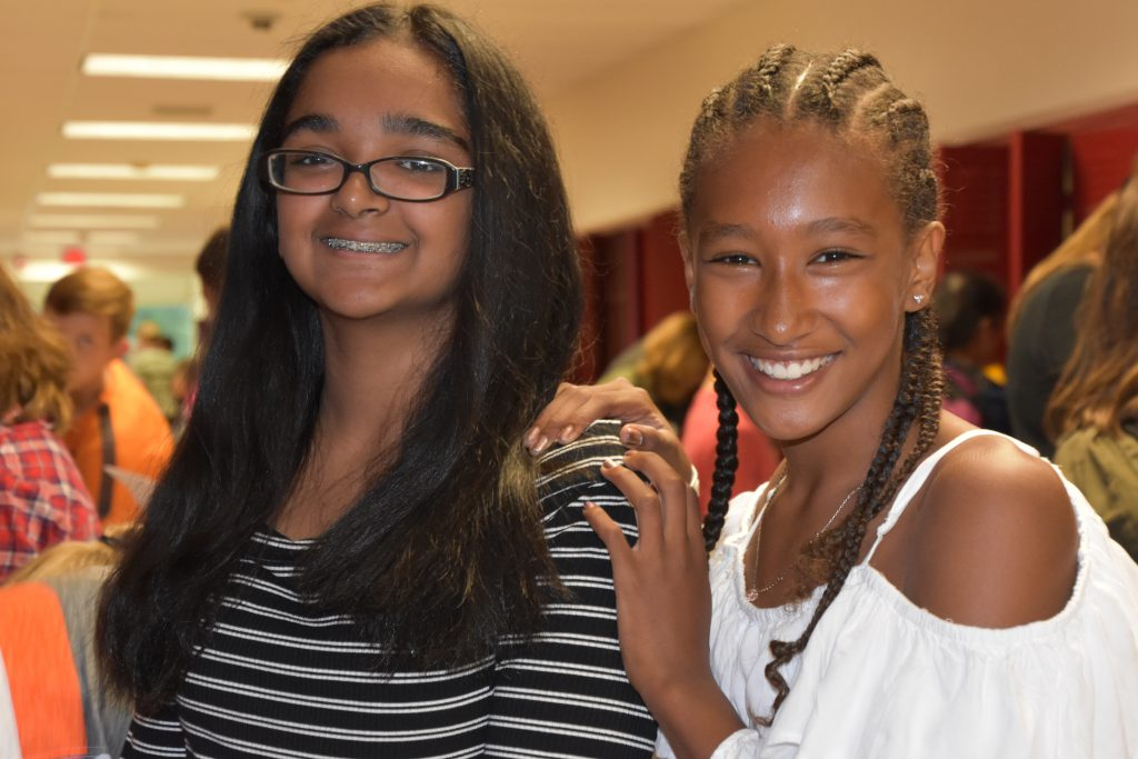 two female students in hallway
