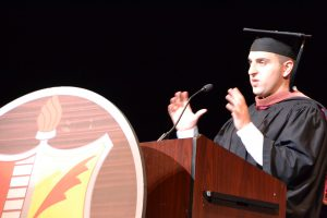 Niskayuna High School graduate Brian Chesky, co-founder and CEO of AirBnb addresses graduates and guests from the podium at graduation in June 2017.