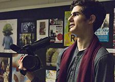 Jad Jacob with his camera in the Niskayuna High School hallway.