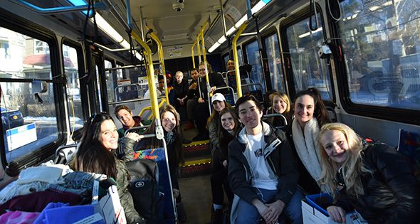 Niskayuna and Schenectady high school students are riding on a bus in Schenectady to do community service.