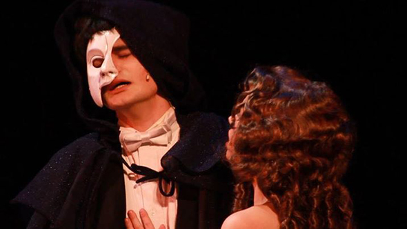 A scene from Niskayuna High School's production of Phantom of the Opera with two cast members in it.