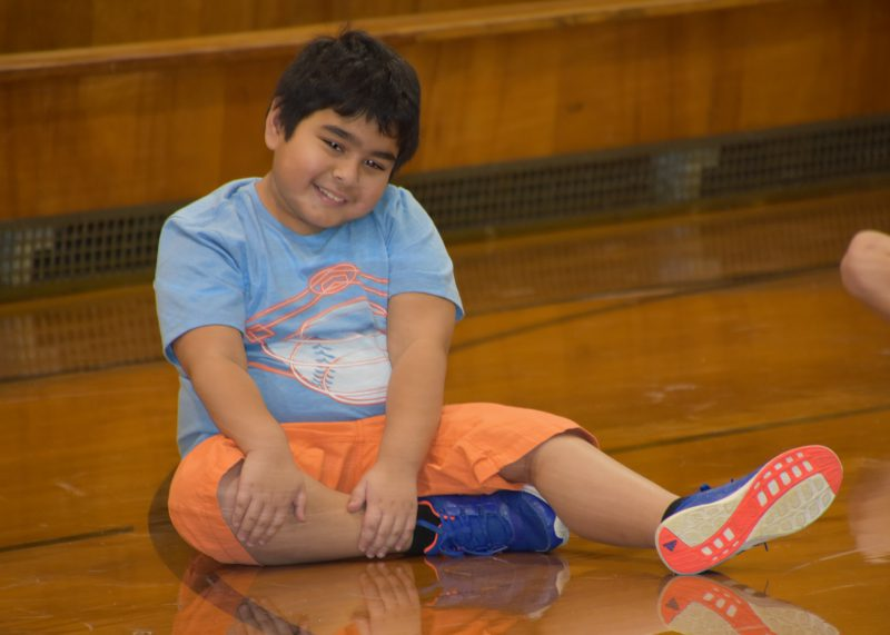 Student stretching during gym class