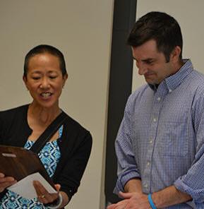 Tina Lee of the Niskayuna Community Foundation shows a plaque to Niskayuna High School English teacher Thomas Lester as part of the Murray Award presentation.