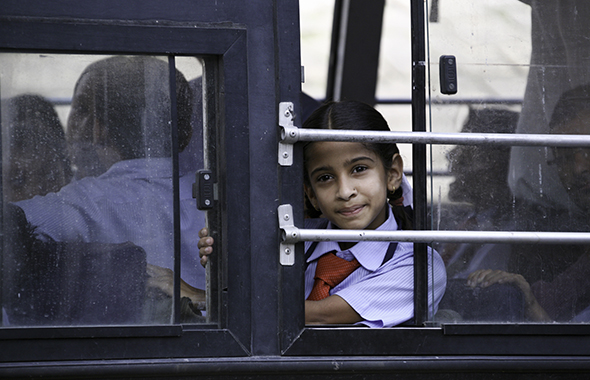 One of Yushi Li's photographs depicting a young girl on a bus.