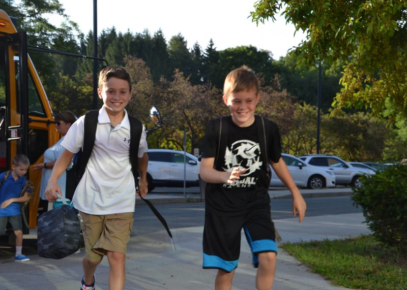 Two students walking into school