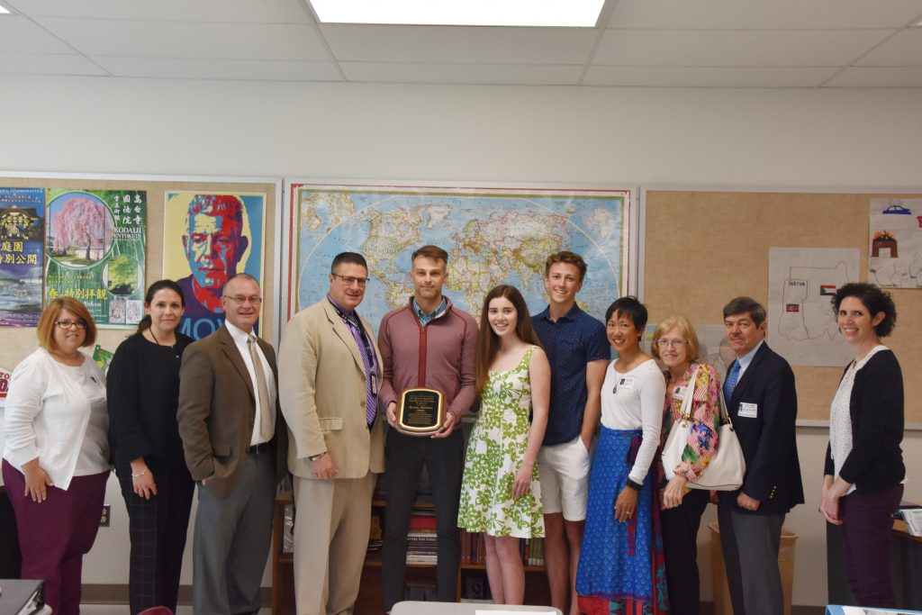 A group shot of approximately 12 people, including students, the award recipient, administrators and members of the Niskayuna Community Foundation