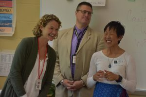 Donna McAndrews, Principal John Rickrt and Tina Lee from the Niskayuna Community Foundation smiling and standing at the front of the classroom