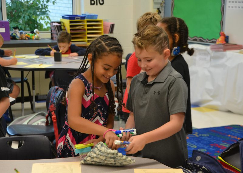 two young students working together