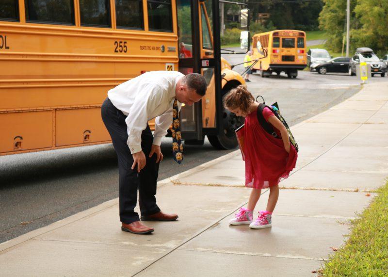 principal looking at a students shoes