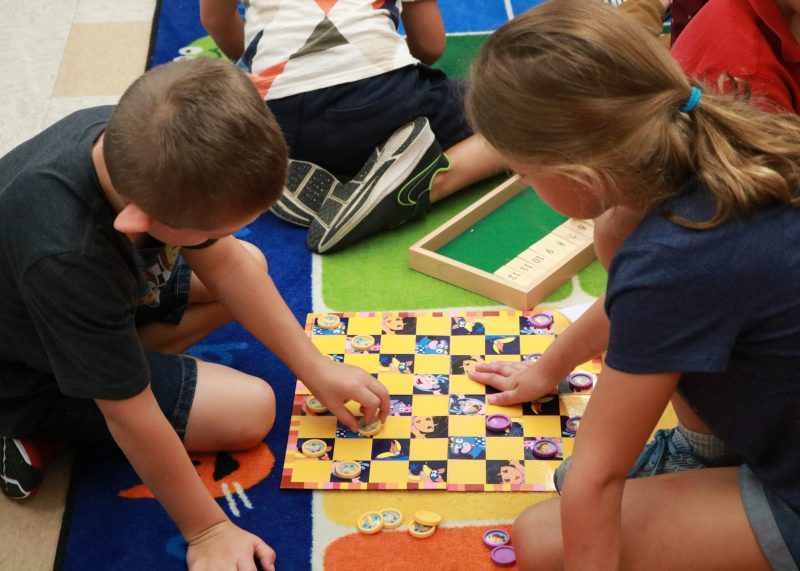 boy and girl playing checkers