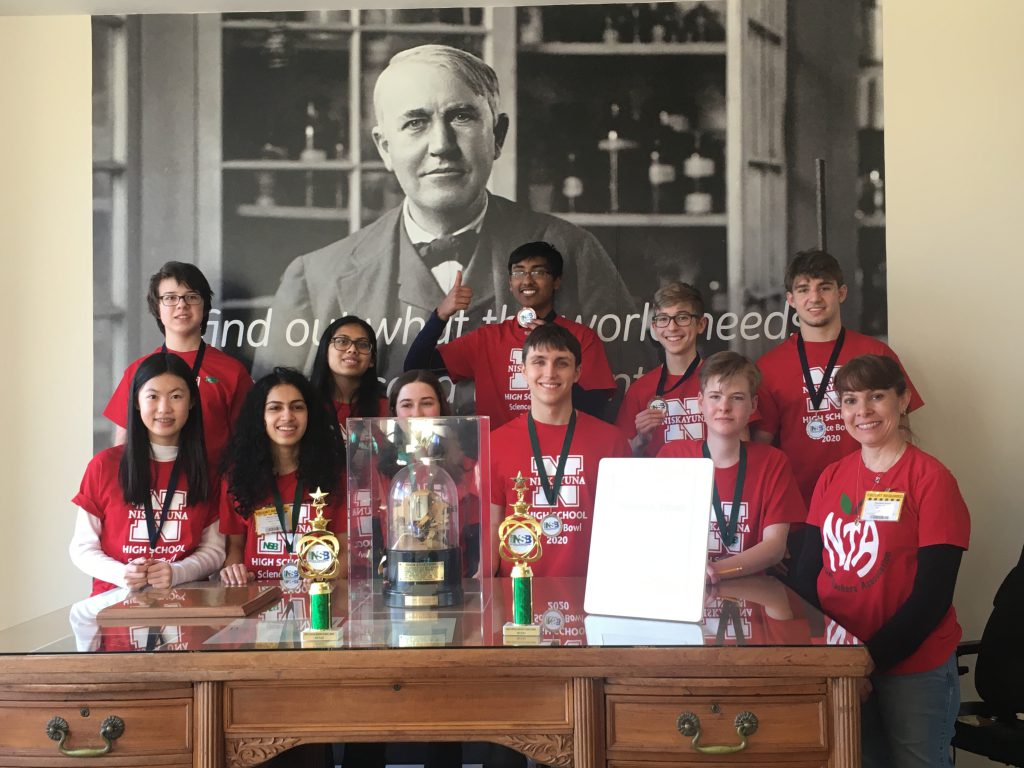 Picture of the NHS Science Bowl Teams posing at Edison's Desk at GE Global Research