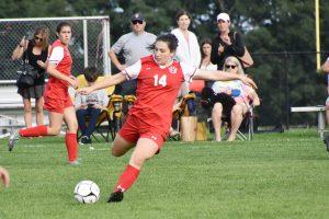 a Niskayuna High School girls soccer player kicking the ball